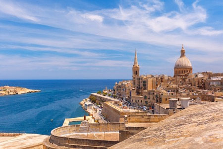 View from above of the domes of churches and roofs with church of Our Lady of Mount Carmel and St. Pauls Anglican Pro-Cathedral, Valletta, Capital city of Malta