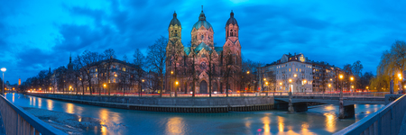 Panorama of Saint Lucas Church, the largest Protestant church in Munich, and Isar River at night, Bavaria, Germany