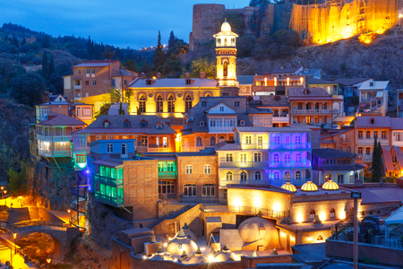 Amazing View of Jumah Mosque, Sulphur Baths and famous colorful balconies in old historic district Abanotubani in night Illumination during morning blue hour, Tbilisi, Georgia. 版權商用圖片 - 87095660