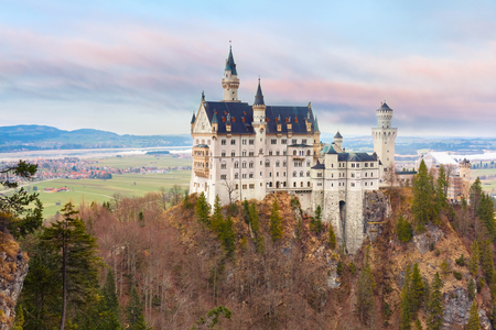 neuschwanstein: World-famous tourist attraction in the Bavarian Alps, fairytale Neuschwanstein or New Swanstone Castle, the 19th century Romanesque Revival palace at sunset, Hohenschwangau, Bavaria, Germany