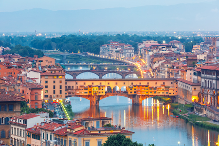 River Arno and famous bridge Ponte Vecchio at twilight from Piazzale Michelangelo in Florence, Tuscany, Italy Stock Photo