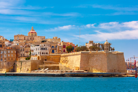 Quay of Valletta with traditional Maltese building with colorful shutters and balconies in the sunny day, Valletta, Capital city of Malta Stock Photo