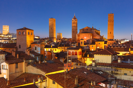 Aerial view of Bologna Cathedral and towers towering above of the roofs of Old Town in medieval city Bologna during evening blue hour, Emilia-Romagna, Italy Stock Photo - 89462699