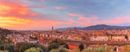 Panorama of Duomo Santa Maria Del Fiore, tower of Palazzo Vecchio and famous bridge Ponte Vecchio at gorgeous sunset from Piazzale Michelangelo in Florence, Tuscany, Italy