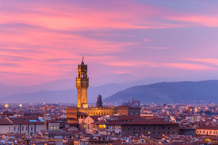 Famous Arnolfo tower of Palazzo Vecchio on the Piazza della Signoria at gorgeous sunset from Piazzale Michelangelo in Florence, Tuscany, Italy