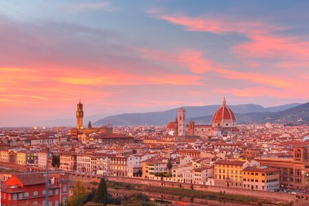 michelangelo: Duomo Santa Maria Del Fiore and tower of Palazzo Vecchio at gorgeous sunset from Piazzale Michelangelo in Florence, Tuscany, Italy