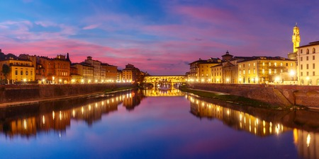 Panoramic view of River Arno and famous bridge Ponte Vecchio at sunset in Florence, Tuscany, Italy Stock Photo