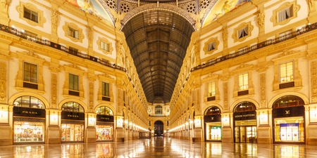 Milan, Lombardia, Italy - October 24, 2017: One of the worlds oldest shopping malls Galleria Vittorio Emanuele II from inside the arcade at night in Milan