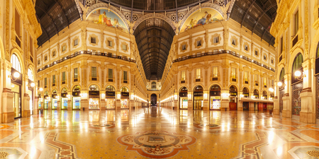 Milan, Lombardia, Italy - October 24, 2017: One of the worlds oldest shopping malls Galleria Vittorio Emanuele II from inside the arcade at night in Milan. Panoramic view
