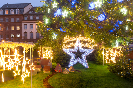 Christmas Tree and inscription Strasbourg Capital of Christmas, Decorated and illuminated on the Place Kleber in Old Town of Strasbourg at night, Alsace, France