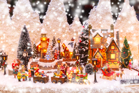 Santa Claus, Christmas tree and toys at a Christmas souvenir market shop in Strasbourg, Alsace, France