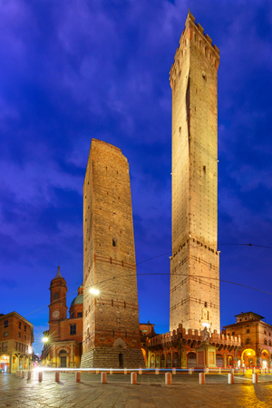 Two Towers, Asinelli and Garisenda, both of them leaning, symbol of Bologna, statue of San Petronius and Church of Saints Bartholomew and Gaetano in the morning, Bologna, Emilia-Romagna, Italy