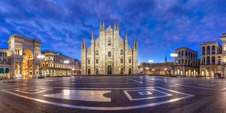 Panorama of the Piazza del Duomo, Cathedral Square, with Milan Cathedral or Duomo di Milano, Galleria Vittorio Emanuele II and Arengario, during morning blue hour, Milan, Lombardia, Italy Stock Photo