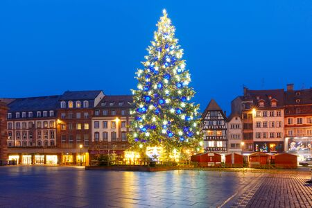 Christmas Tree Decorated and illuminated on the Place Kleber in Old Town of Strasbourg at night, Alsace, France