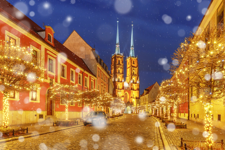 Cathedral of St. John at Cathedral Island or Ostrow Tumski at snowy christmas night in Wroclaw, Poland