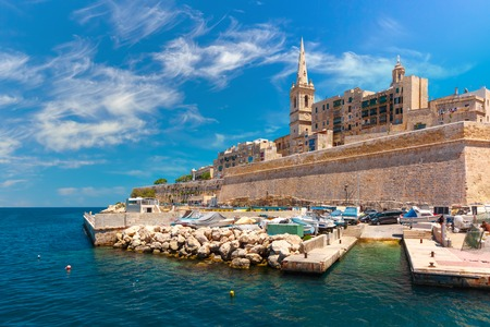 Valletta Skyline with fortress wall, boat pier and St. Pauls Anglican Pro-Cathedral, Valletta, Capital city of Malta. View from the sea