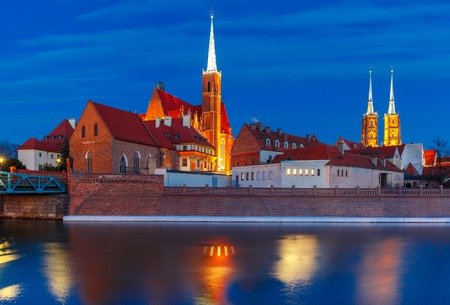 Cathedral Island or Ostrow Tumski with Cathedral of St. John and church of the Holy Cross and St. Bartholomew at night in Wroclaw, Poland Stock Photo