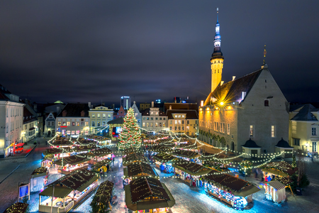 Decorated and illuminated Christmas tree and Christmas Market at Town Hall Square or Raekoja plats, Tallinn, Estonia. Aerial view