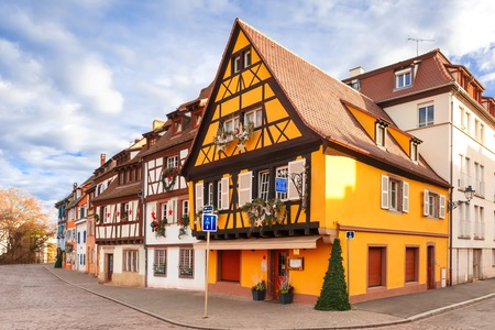 Traditional Alsatian half-timbered houses in Petite Venise or little Venice, old town of Colmar, decorated at christmas time in sunny day, Alsace, France Stock Photo