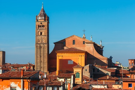 Aerial view of Bologna Cathedral towering above of the roofs of Old Town in medieval city Bologna in the sunny day, Emilia-Romagna, Italy