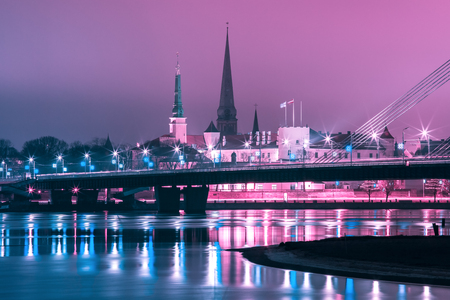 Old Town of Riga and River Daugava at night, church and Riga castle in the background, Latvia Stock Photo