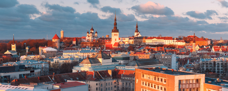 Aerial panoramic cityscape with Medieval Old Town with Saint Nicholas Church, Cathedral Church of Saint Mary and Alexander Nevsky Cathedral in Tallinn at sunset, Estonia