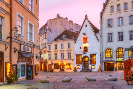 Morning decorated and illuminated Christmas street in Old Town of Tallinn at sunrise, Estonia