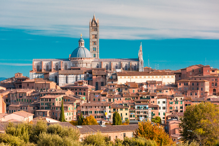 Beautiful view of Dome and campanile of Siena Cathedral, Duomo di Siena, and Old Town of medieval city of Siena in the sunny day, Tuscany, Italy