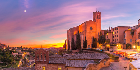 Beautiful panoramic view of Basilica of San Domenico, also known as Basilica Cateriniana, in medieval city of Siena at gorgeous sunset, Tuscany, Italy