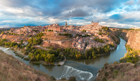 Panorama of Old city of Toledo and river Tajo in the overcast day, Castilla La Mancha, Spain