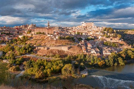 Panoramic aerial view of Old city of Toledo with Cathedral, Alcazar and river Tajo at dusk, Castilla La Mancha, Spain Stock Photo