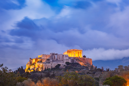 Aerial view of the Acropolis Hill, crowned with Parthenon during evening blue hour in Athens, Greece