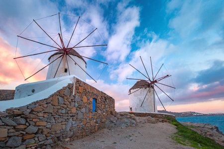 Famous view, Traditional windmills on the island Mykonos, The island of the winds, at sunrise, Greece