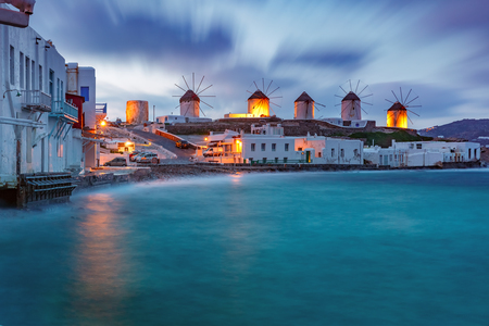 Famous view, Traditional windmills on the island Mykonos, The island of the winds, at cloudy sunrise, Greece