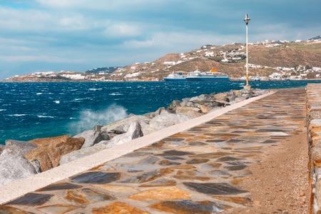 Pier in harbour of Mykonos City, Chora, in cloudy day, island Mykonos, Greece