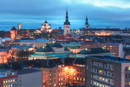 Aerial panoramic cityscape with Medieval Old Town illuminated with Saint Nicholas Church, Cathedral Church of Saint Mary and Alexander Nevsky Cathedral in Tallinn in the evening, Estonia