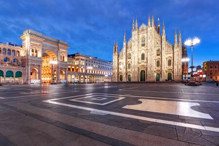 Panorama of the Piazza del Duomo, Cathedral Square, with Milan Cathedral or Duomo di Milano and Galleria Vittorio Emanuele II, during morning blue hour, Milan, Lombardia, Italy Stok Fotoğraf