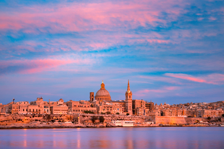 Valletta Skyline at beautiful sunset from Sliema with churches of Our Lady of Mount Carmel and St. Pauls Anglican Pro-Cathedral, Valletta, Capital city of Malta