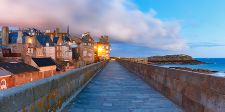 Night panoramic view of beautiful walled city Intra-Muros in Saint-Malo, also known as city corsaire, Brittany, France