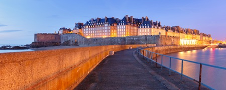 Night panoramic view of famous walled port city of Privateers Saint-Malo is known as city corsaire, Brittany, France