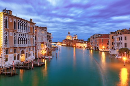 Grand canal and The Basilica of St Mary of Health or Basilica di Santa Maria della Salute at night in Venice, Italy Stock Photo