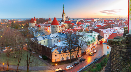Aerial panoramic cityscape with Medieval Old Town, St. Olaf Baptist Church and Tallinn City Wall in the morning, Tallinn, Estonia Standard-Bild