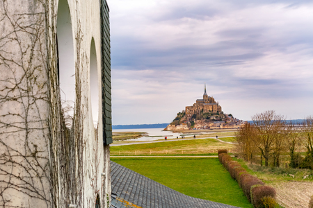Beautiful famous Mont Saint Michel in the cloudy day, Normandy, France