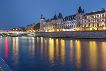 Beautiful view of Seine and Conciergerie at night in Paris, France Banco de Imagens