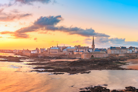 Walled city Saint-Malo with St Vincent Cathedral at sunrise at high tide