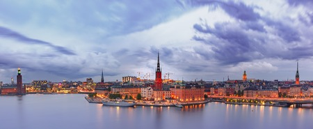 Scenic aerial panoramic view of Riddarholmen, Gamla Stan, in the Old Town in Stockholm at night, capital of Sweden