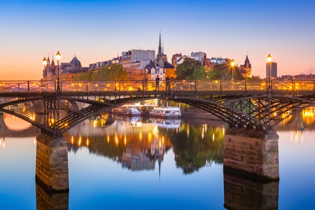 Beautiful view of Ile de la Cite and Pont des Arts at sunrise in Paris, France