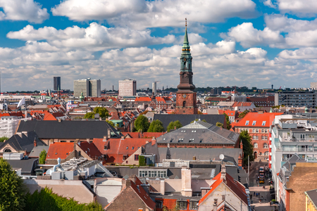 Scenic summer aerial view of Old Town skyline with St. Peters Church and lot of red roofs as seen from The Round Tower, Copenhagen, capital of Denmark Banco de Imagens