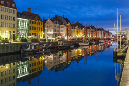 Nyhavn with colorful facades of old houses and old ships in the Old Town of Copenhagen, capital of Denmark. Imagens