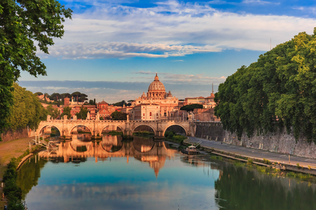 Saint Peter Cathedral and Saint Angel bridge over the Tiber River in the morning in Rome, Italy.